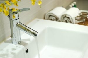washbasin and faucet in bathroom.Bathroom interior.Towels in bathroom.